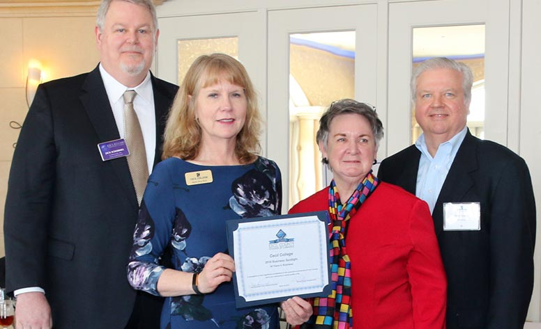 This is a photo of Dr. Bolt received an award at the Cecil County Chamber luncheon
