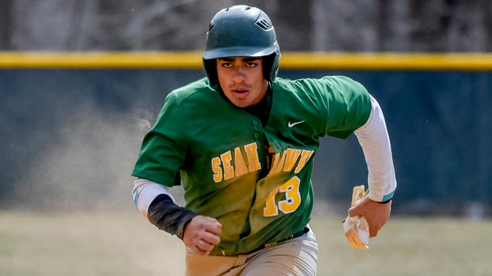 Men's baseball player running