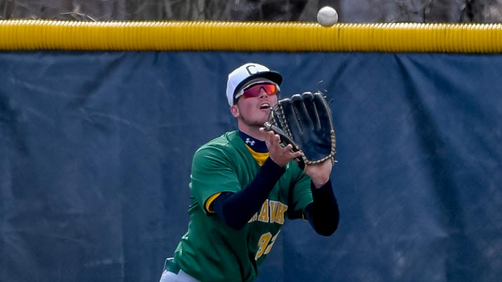 Men's baseball player catching a ball