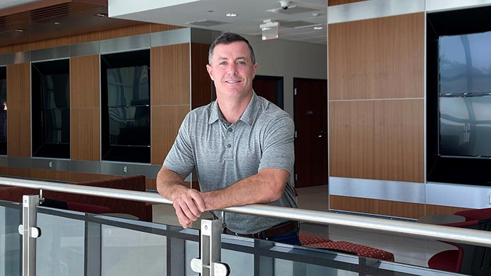 Photo of Keith Brown standing in the lobby of the Engineering and Math Building