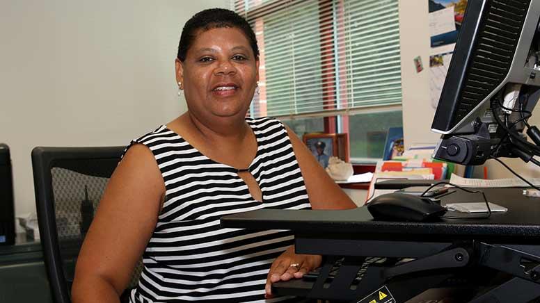 Photo of Cheryl Davis-Robinson sitting at her desk.
