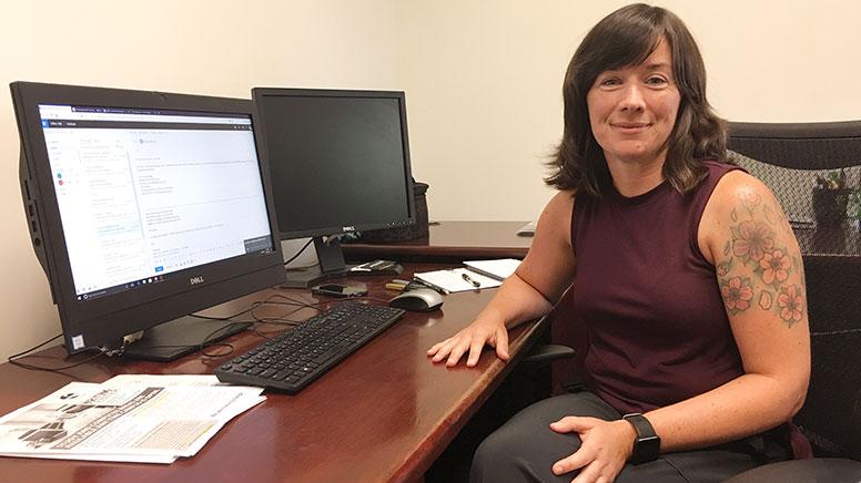 photo of Lauren Hornberger sitting at her desk