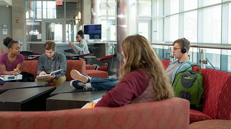 Students relaxing in the EMB lounge area.