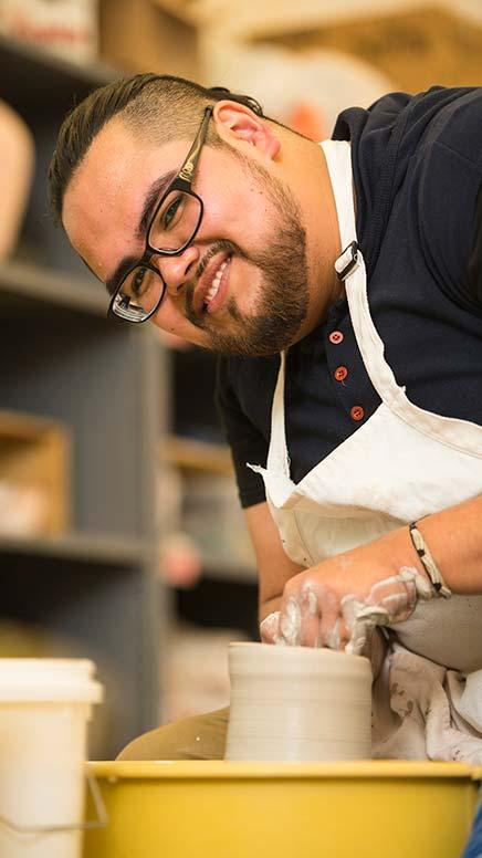 Oscar Zarco working on the pottery wheel