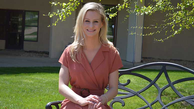 Rachel VanHorn is sitting on a bench in the quad of the North East Campus of Cecil College.