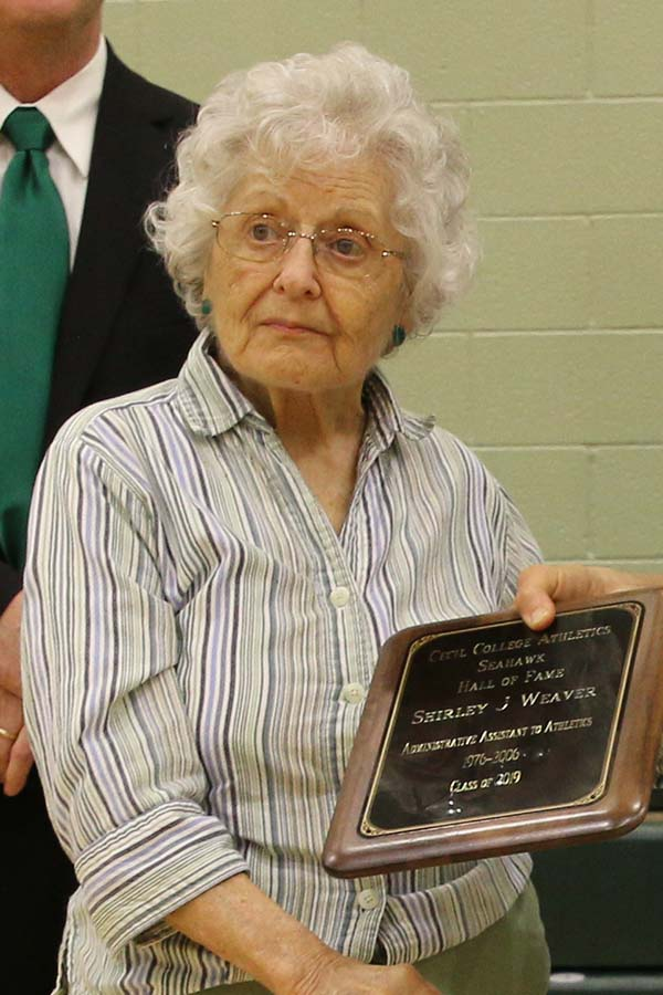 Shirley Weaver holding plague
