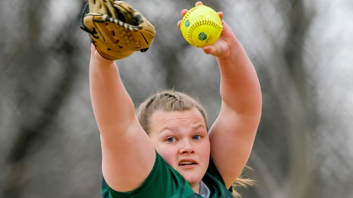 Women's softball player pitching