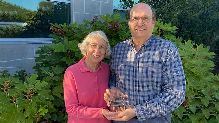 Photo of Barb and Jim Sweigard holding their presented award