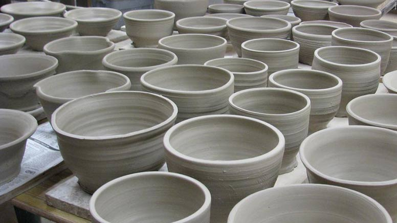 Table of clay bowls from the throw-a-thon
