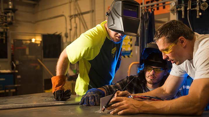 Cecil College welding students working with instructor