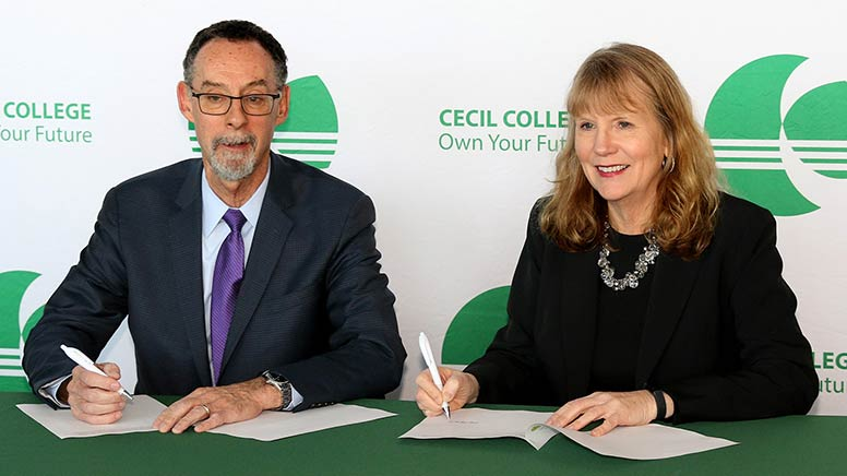 West Chester University President Dr. Christopher M. Fiorentino and Cecil College President Dr. Mary Way Bolt sign a new articulation agreement that allows a smooth transition for students who graduate from Cecil College's Early College Academy (ECA) program to complete a four-year degree at West Chester University.