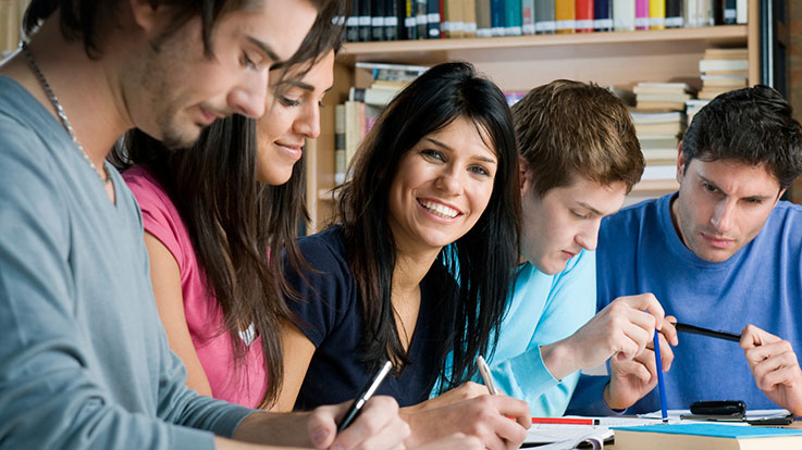 Adult students in a classroom setting.