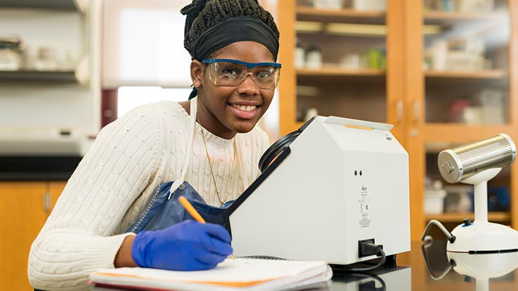 A student using lab equipment.