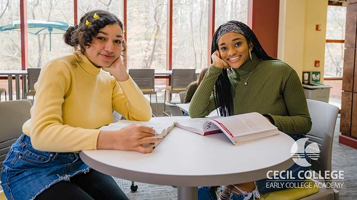 Two students at a table.