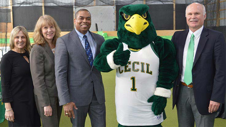 Some of Cecil College's senior leadership with the College's official mascot.
