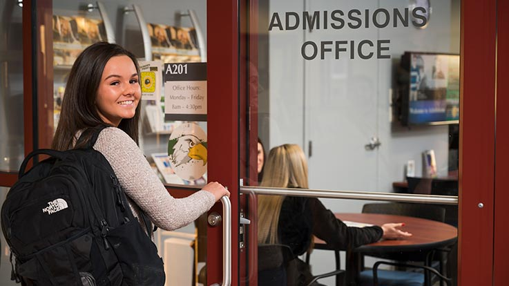 A student entering Cecil College's admissions office.