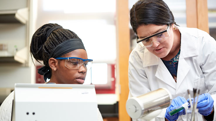 Instructor helping a student in the lab
